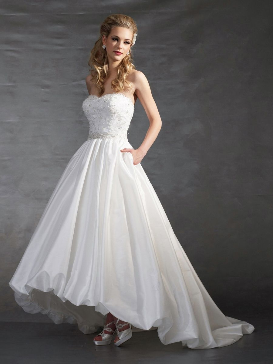 A traditional ball gown or trumpet dress wedding dress wedding