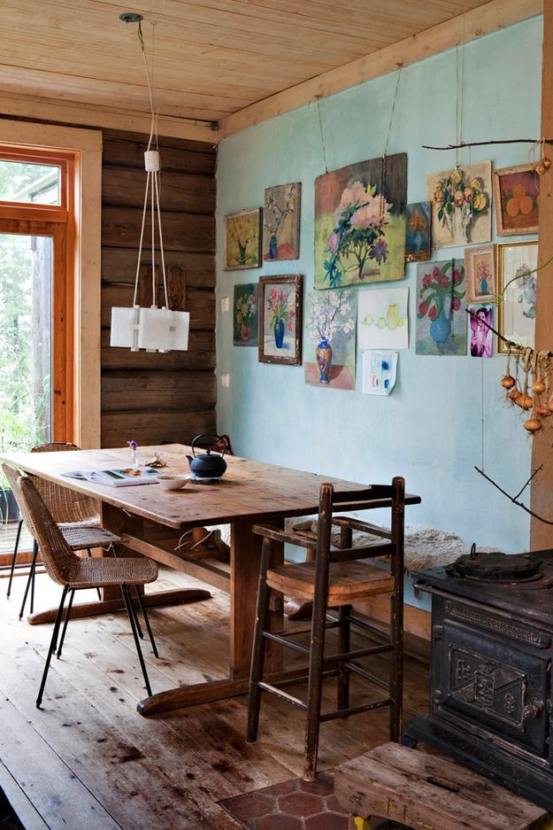 Painting And Sketches Of Flowers Rustic Dining Room Light Blue Wall Color Lots Wood