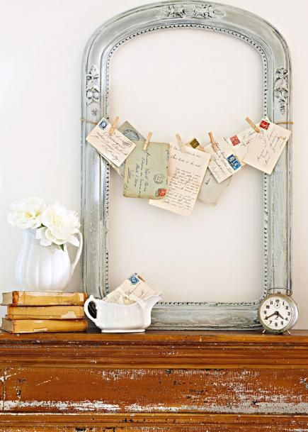 Empty frame with old postcards and letters
