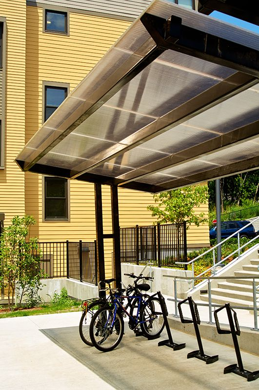 Bike Parking Shelters : Covered outdoor bike parking with the slope shelter