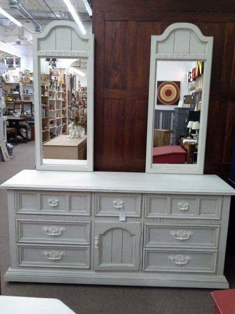 this is a vintage 9 drawer dresser with
