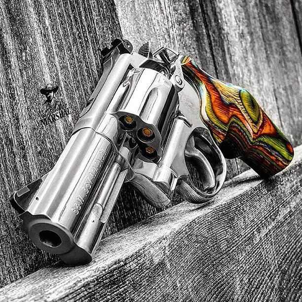 Hogue lamo-camo grips on a Smith & Wesson 686  Original photo from