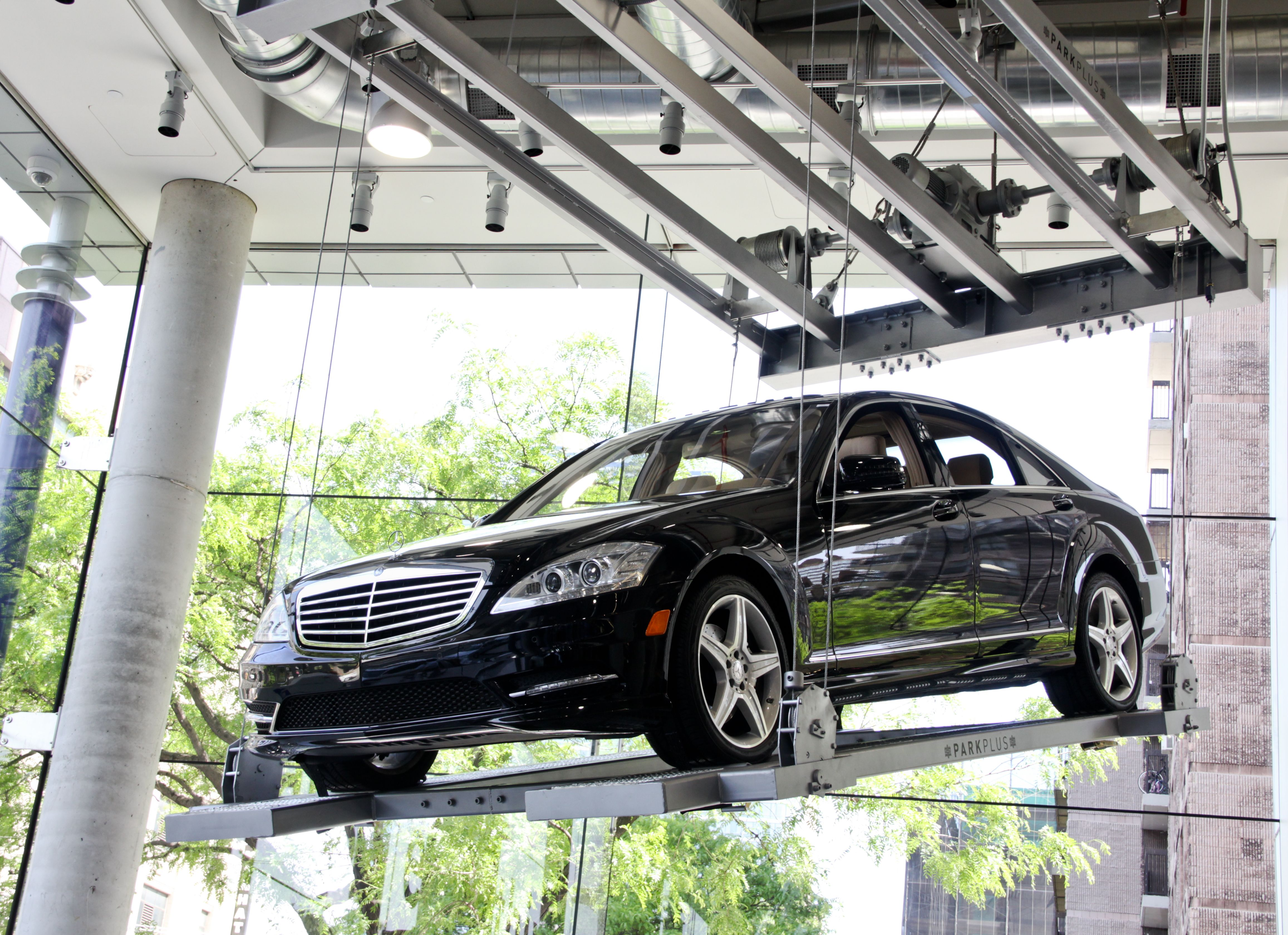 Mercedes Benz S550 Hanging From The Ceiling In The New Car