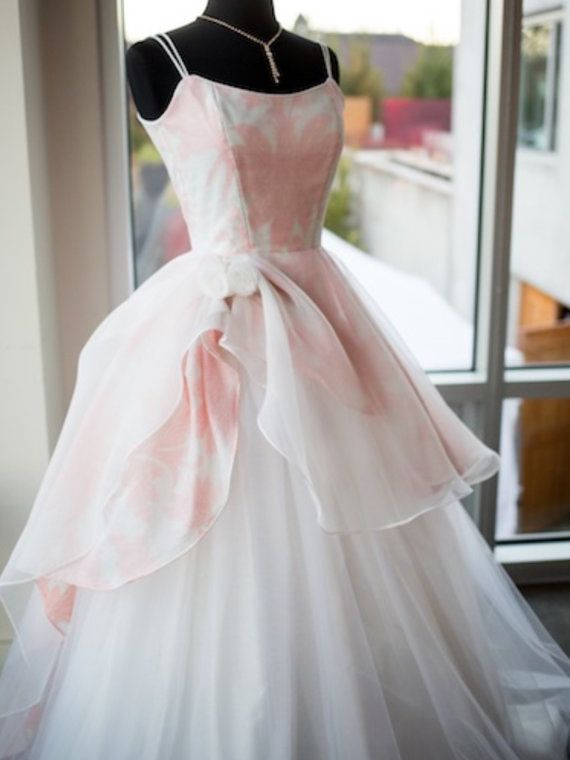 Enchanted is a long floral wedding gown made from a sheer silk ...