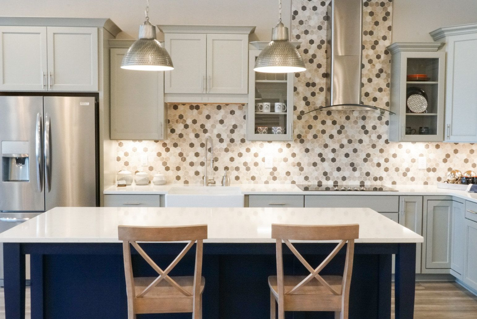 We Love The Mix Of Gray Cabinets And The Blue Island Our Customers Can See This Beautiful Combination In Our New D In 2020 New Home Construction Kitchen Grey Cabinets