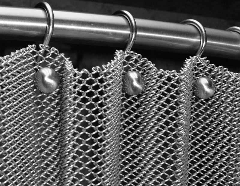 c9eefdcbe The detail installation of silvery metal coil drapery on stainless steel  rod linked with rings and screws.