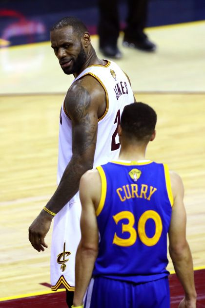 031175c4caef LeBron James looks at Stephen Curry after blocking a shot in Game 6 of the  2016