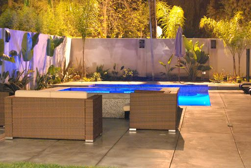 Swimming Pool in Woodland Hills, featuring luxury patio furniture.