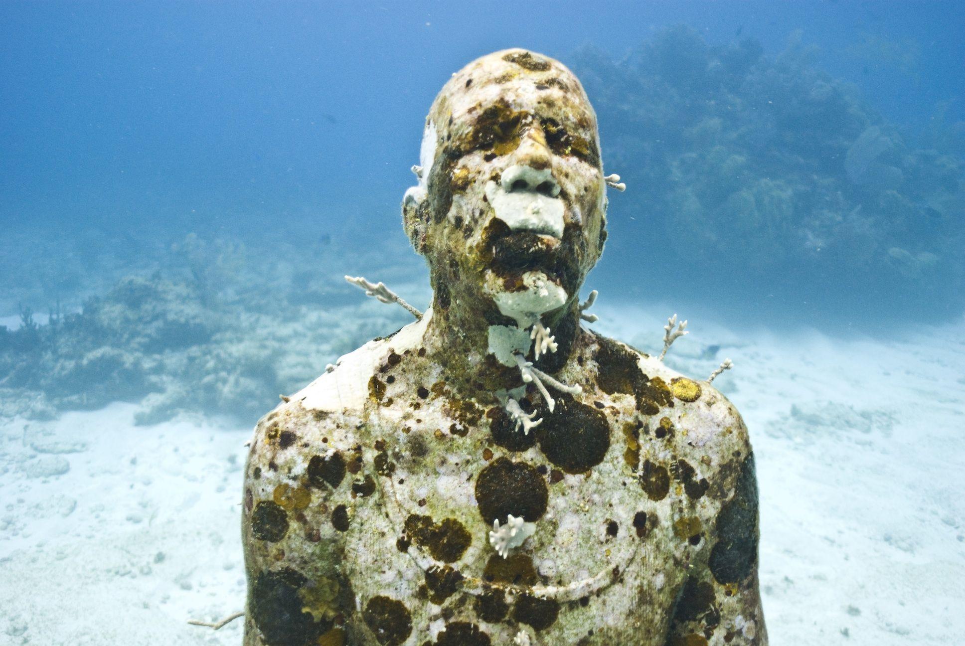 Jason deCaires Taylor - underwater sculpture: man on fire.
