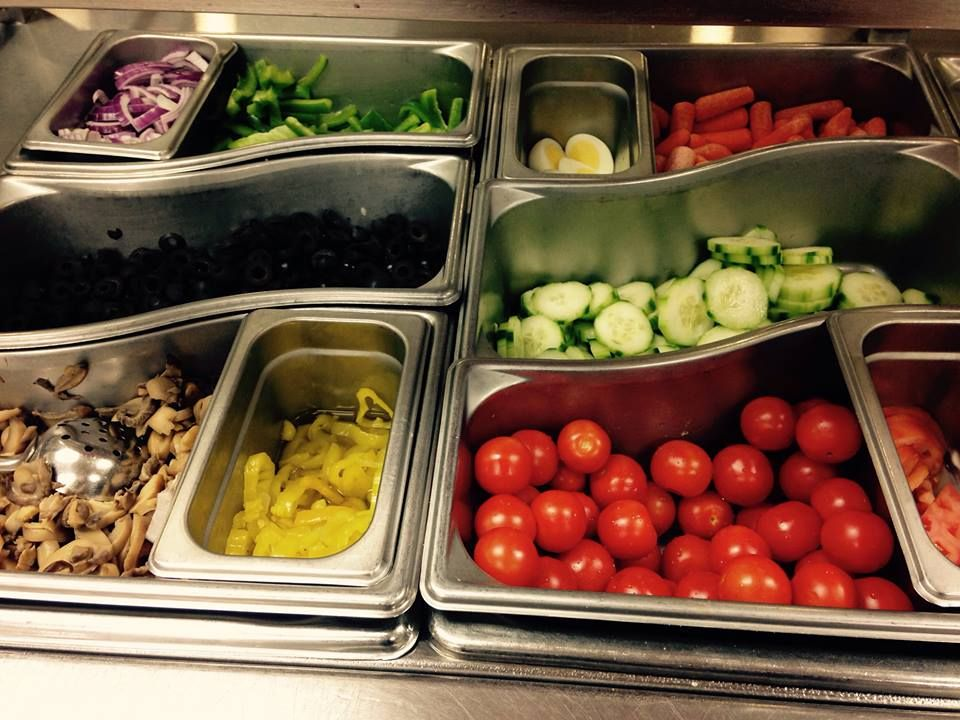 Millbury Memorial Jr./ Sr. High School salad bar uses these curved pans by