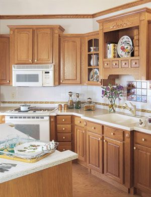 White Kitchen Oak Cabinets painting kitchen cabinets white and adding beadboard. description