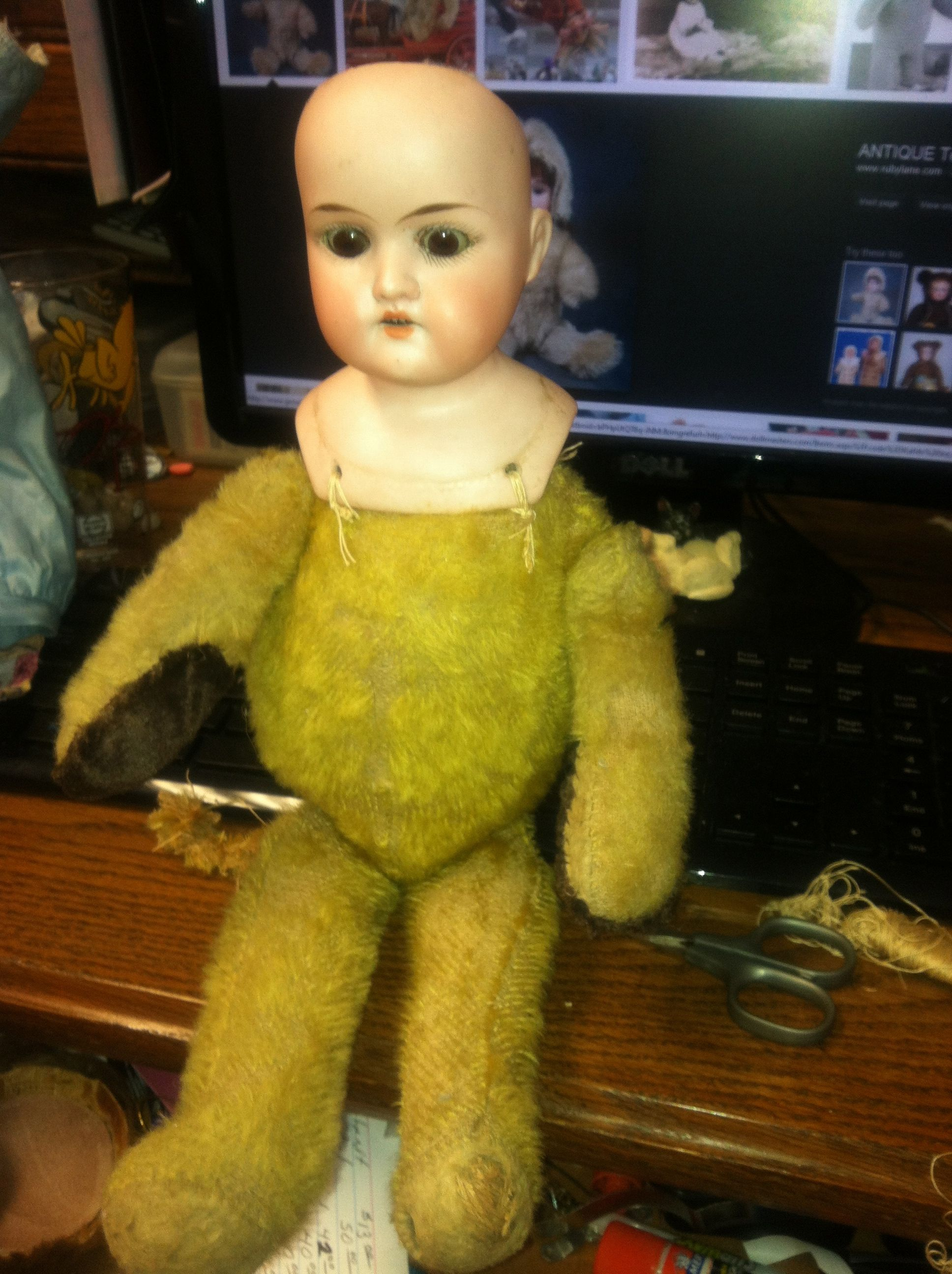 A Teddy with a broken head and a doll with no body !
