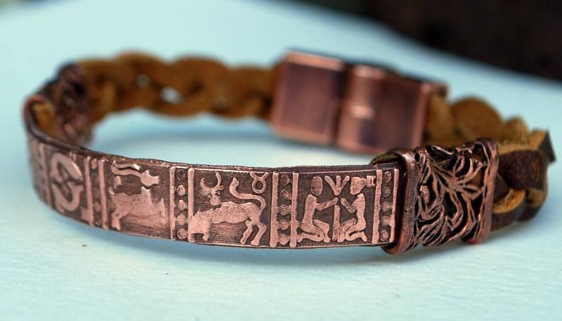 Zodiac Bracelet.....solid copper focal...magnetic clasp ~ hand braided soft leather ~ $30 orrtec@gmail.com  https://www.facebook.com/MelindaOrrDesigns