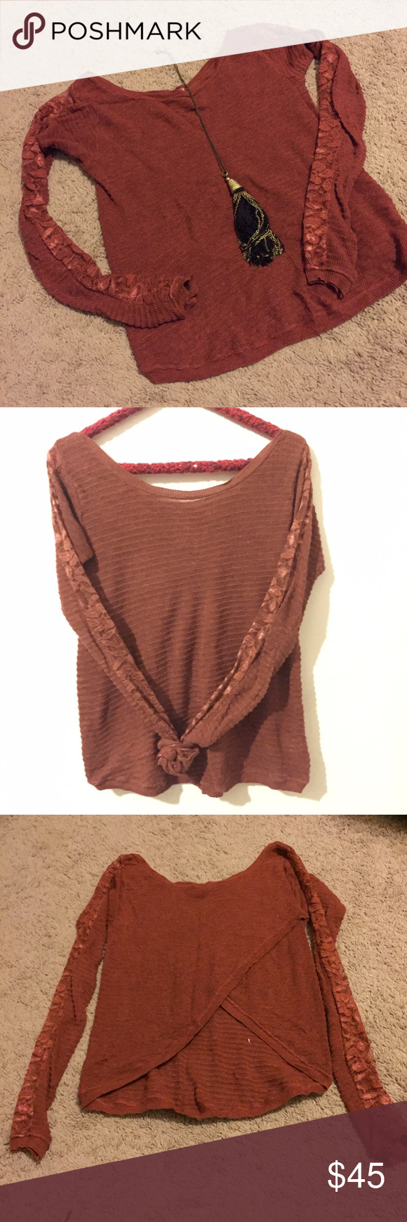 "Free People Lace Sleeve Sweater Tulip Back Large Free People Lace Sleeve Sweater--texture on texture! This is a lightweight sweater in a beautiful burnt orange--a great color for fall. The neckline is a scoop neck with a bit of boat neck thrown in. The back is a Tulip Back, it is shorter in the back and a bit open---measures 12"" from neckline to where the layers meet in the back. It is longer in the front---length Measures 20"". Size Large, runs a tad small, fit is fitted on a large but is a…"
