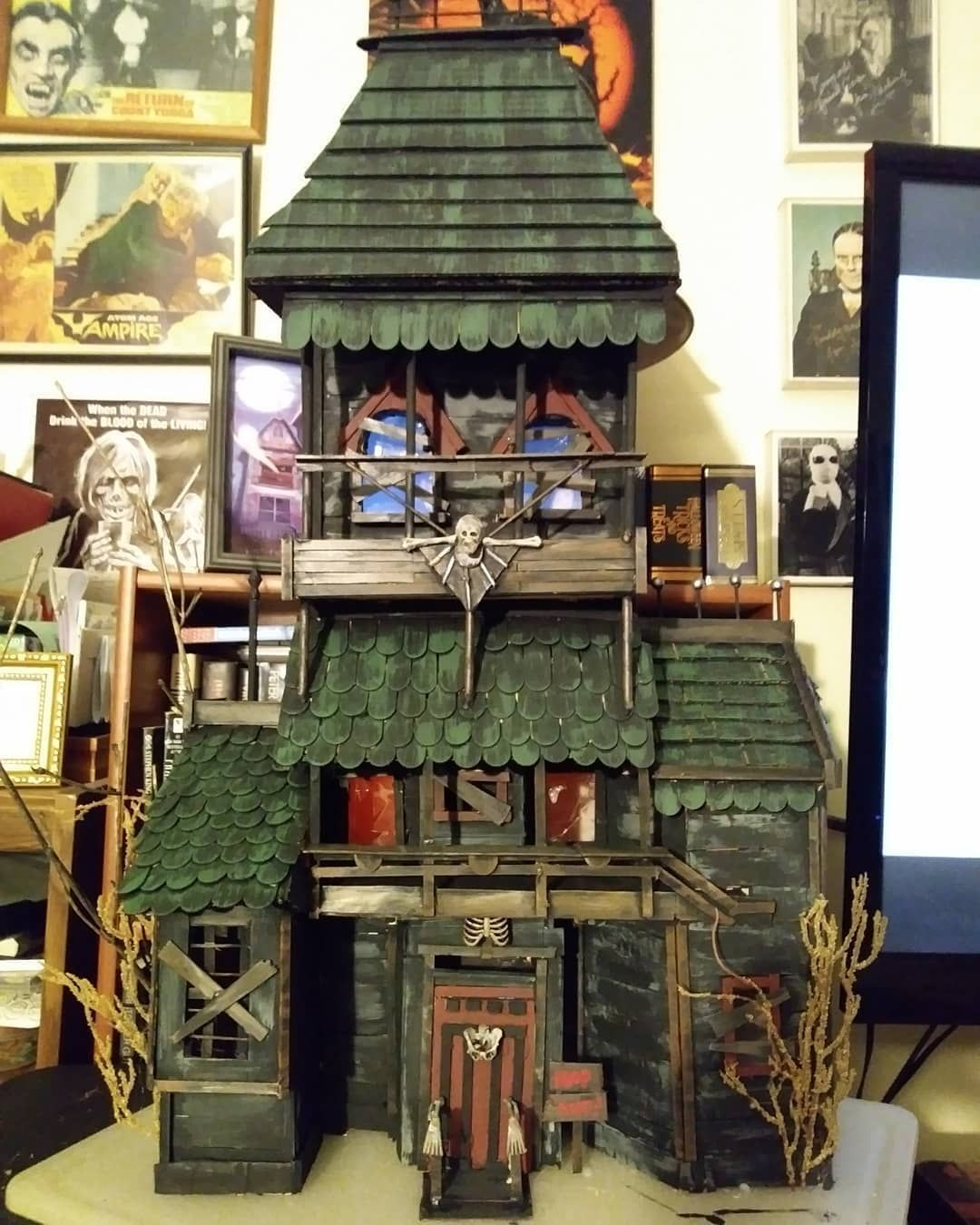 I always wanted to have a haunted dollhouse... So I made one! 5 days of glue gun burns, measuring and cutting. I made this totally out of craft sticks, cereal boxes, and various odds and ends. Total height, 3 feet, total cost to make, about $10.00! #hauntedhouse #halloween #halloweencrafts #creepycrafts #horrorislife #creepyhouse #dyihalloween #diyhalloweendecorations #gothlife #craftymom #haunteddollhouse #miniatures #everydayishalloween #halloweendecorations #haunteddollhouse I always wanted t #haunteddollhouse
