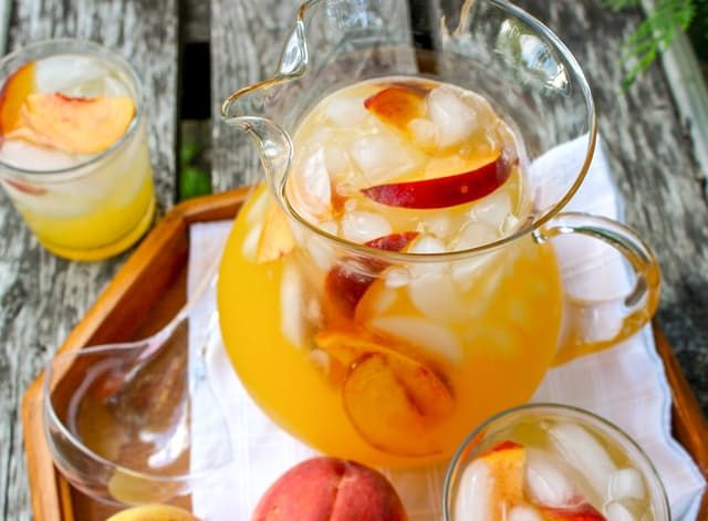 Two of the best parts of summer are ice-cold lemonade and fresh-picked juicy peaches. Combine them, add a little vodka and some sparkling water, and now you've got the third best part: a pitcher cocktail to kick off the weekend.