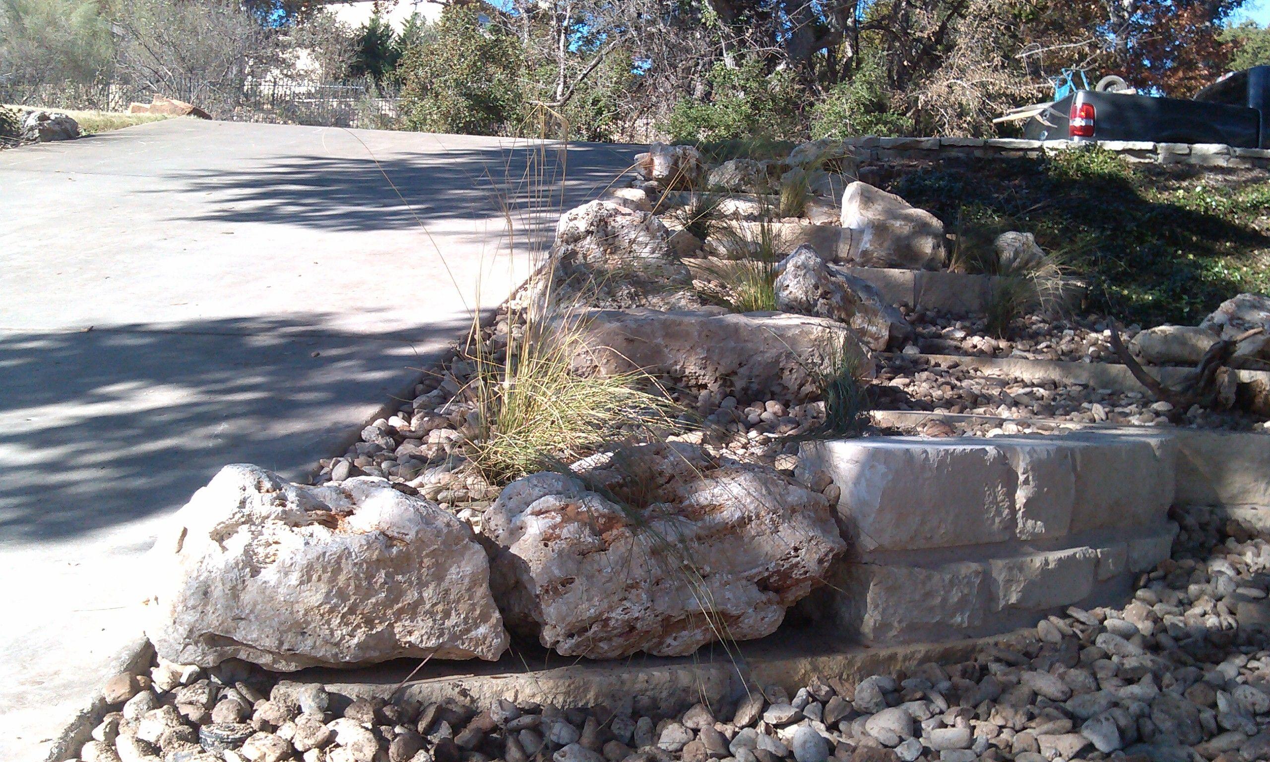 Limestone retaining walls with limestone boulders set in for Limestone landscape rock