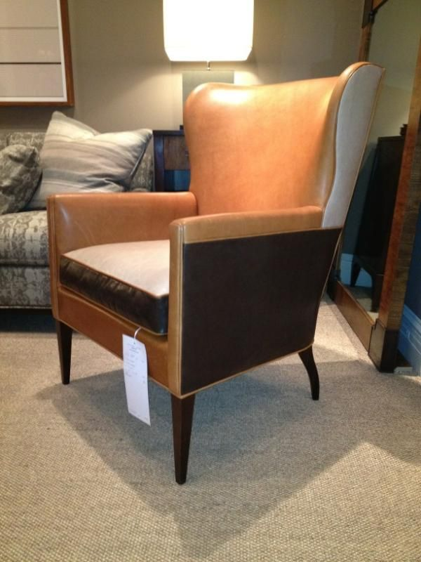 #HickoryChair shows real style with this multi-toned leather wing chair. How mod! #HPMkt. I can see it placed with a sofa in the darkest tone on the chair - unity without overkill.