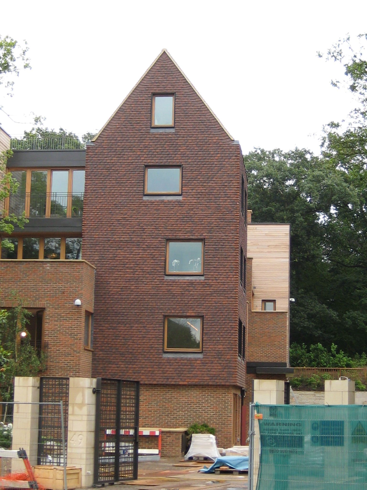 View of Bishop's Avenue brick facade by GRID Architects