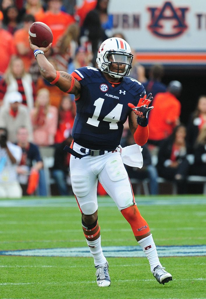 Nick Marshall 14 of the Auburn Tigers passes against the