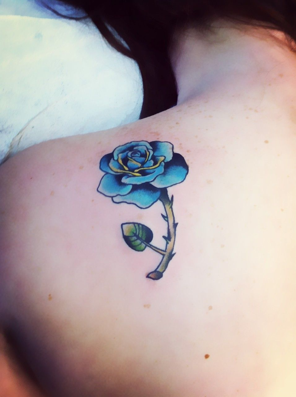 Beautiful blue rose with thorns watercolor tattoo on for Rose with thorns tattoo