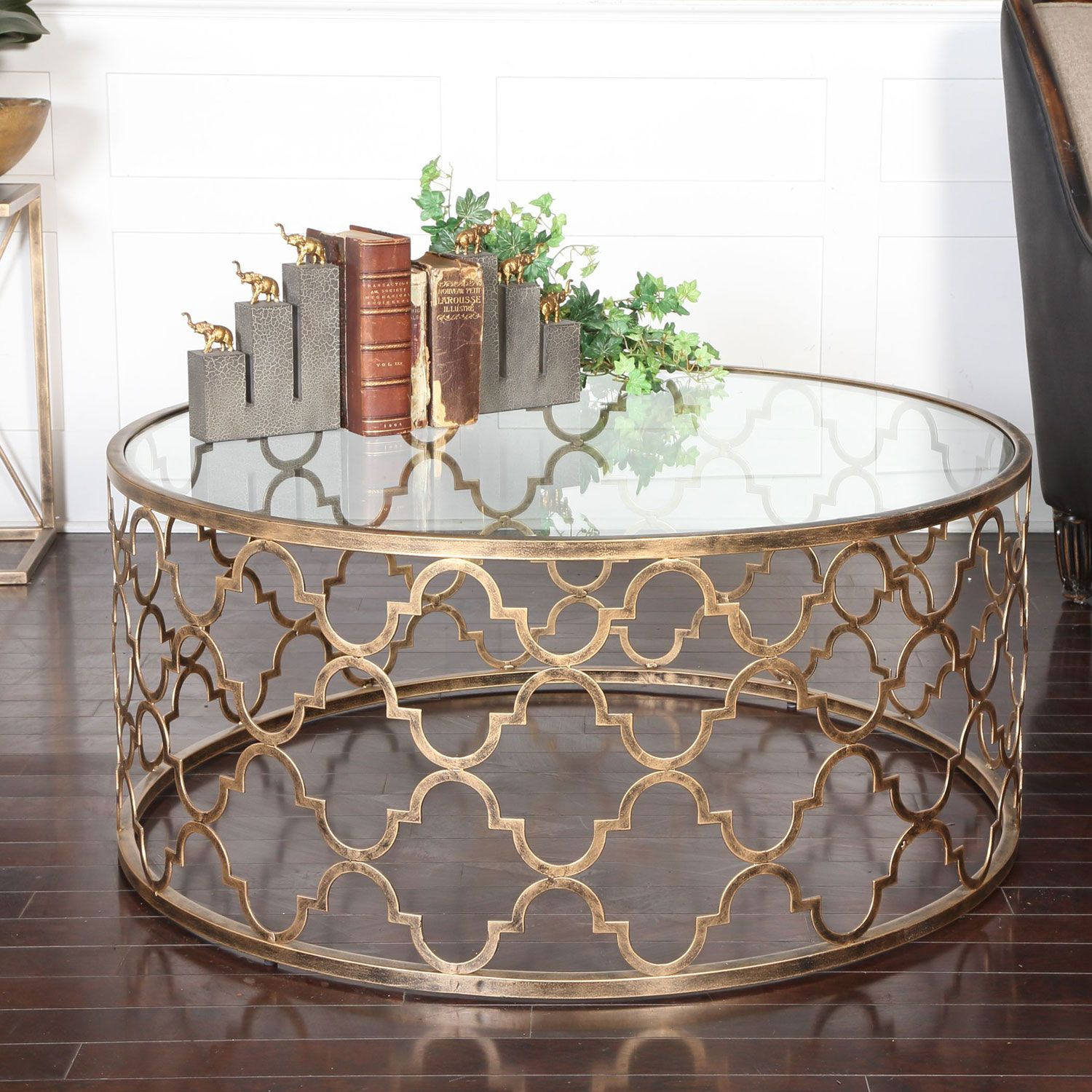 Heavy iron in antique gold finish with clear tempered glass uttermost accent furniture combines premium quality materials with unique high style design