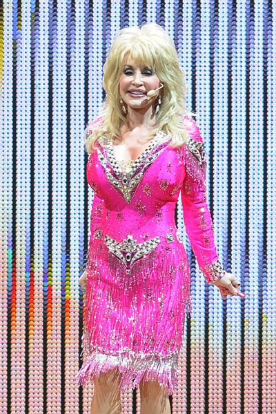 Dolly Parton Dazzles In Short Pink Dress At Hard Rock Live Performance
