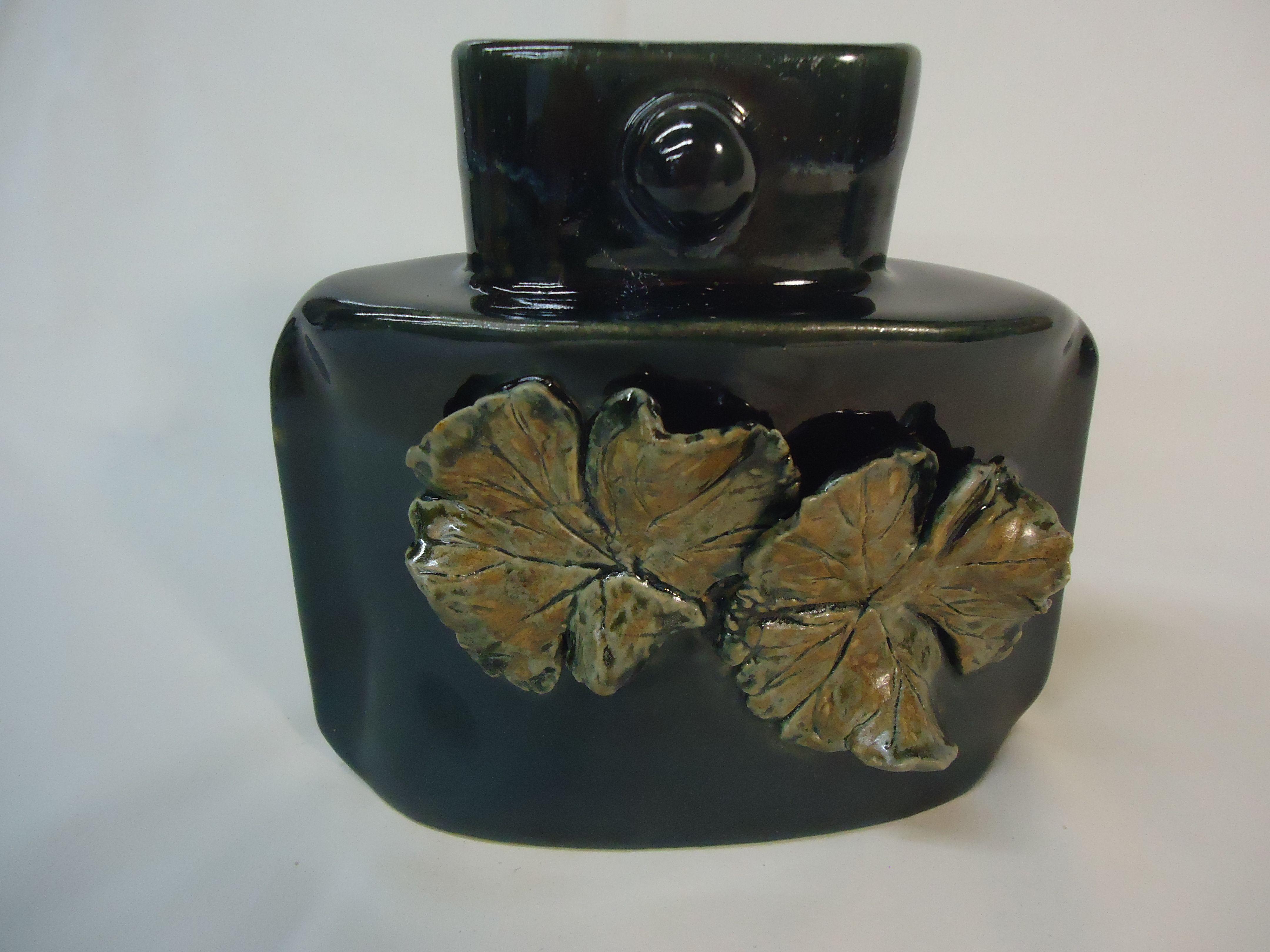 handbuilt oval Geranium vase - gloss black with Autumn Green leaves - Michael MacDonald