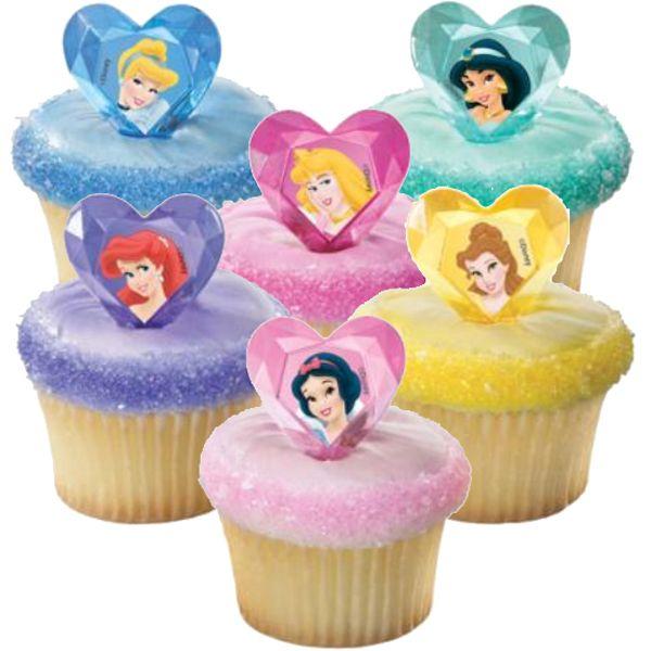 Cupcakes en crema con toppers plasticos, figuras princesas