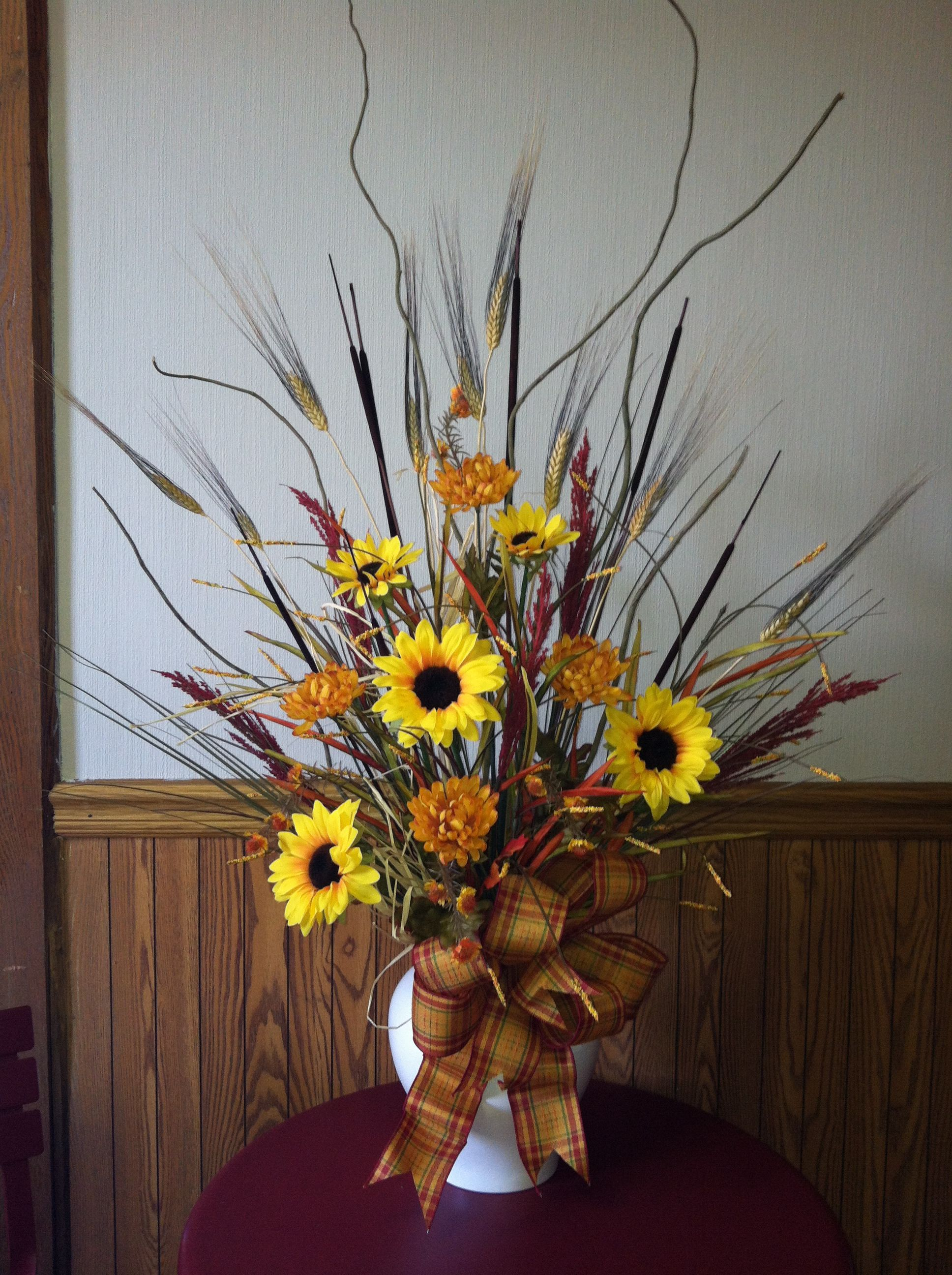 Tall flower arrangement with sunflowers and mums for fall