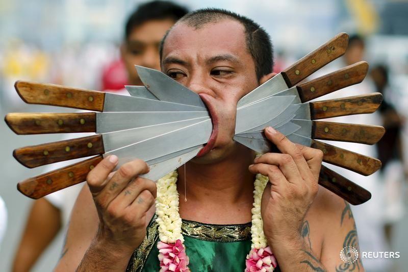 Reuters • reuterspictures:    Face of blades      Devotees...