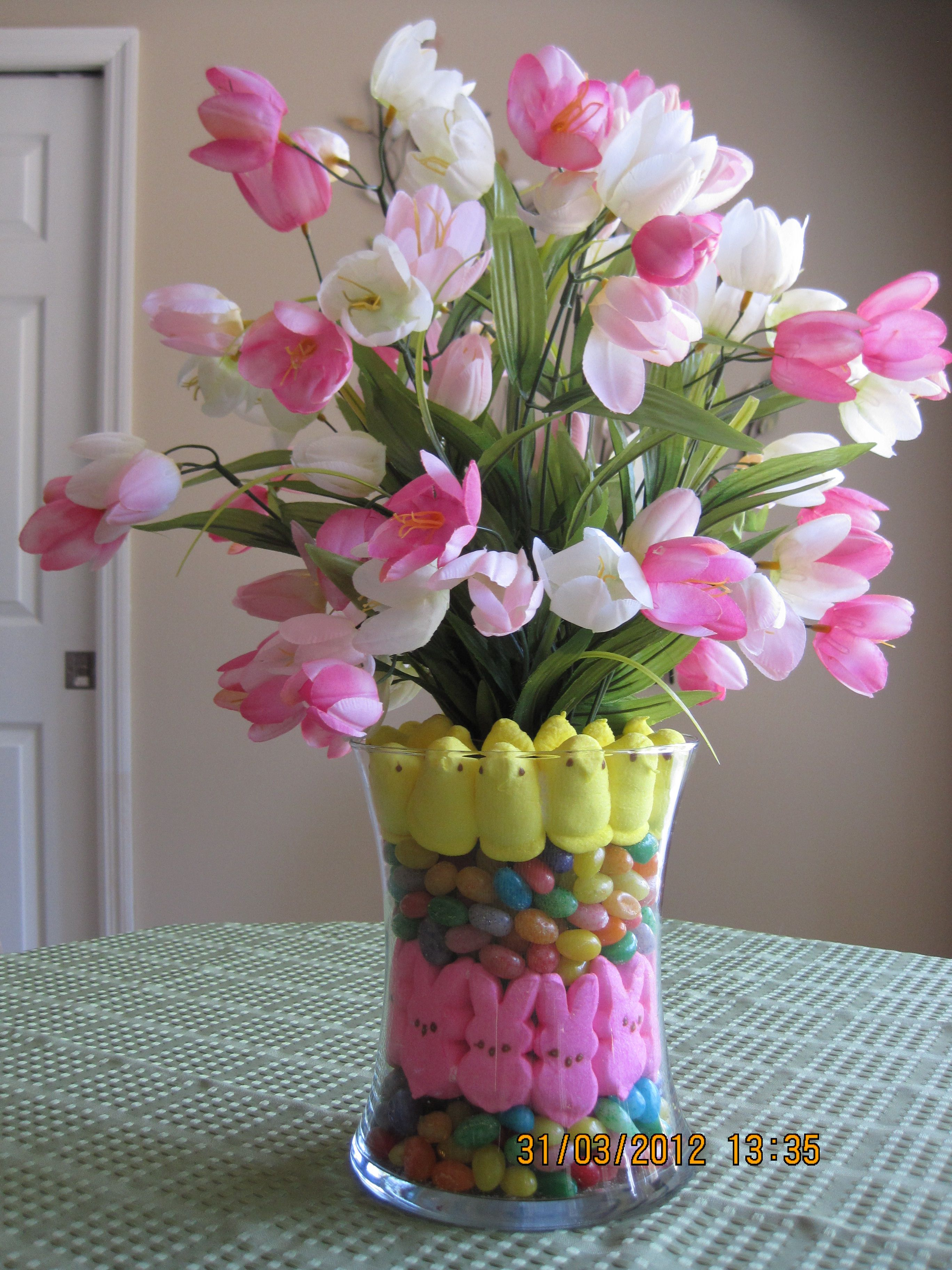Easter Centerpiece ~ simply place a vase within a vase, fill with candy layers, add flowers and you have an easy, fun arrangement.. Easter ideas