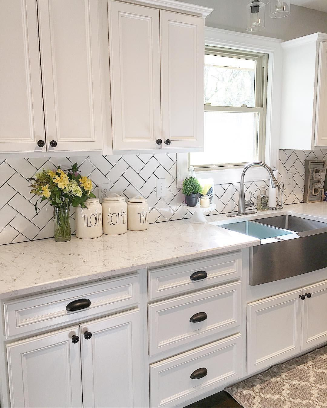 White kitchen kitchen decor subway tile herringbone for White kitchen cabinets black hardware