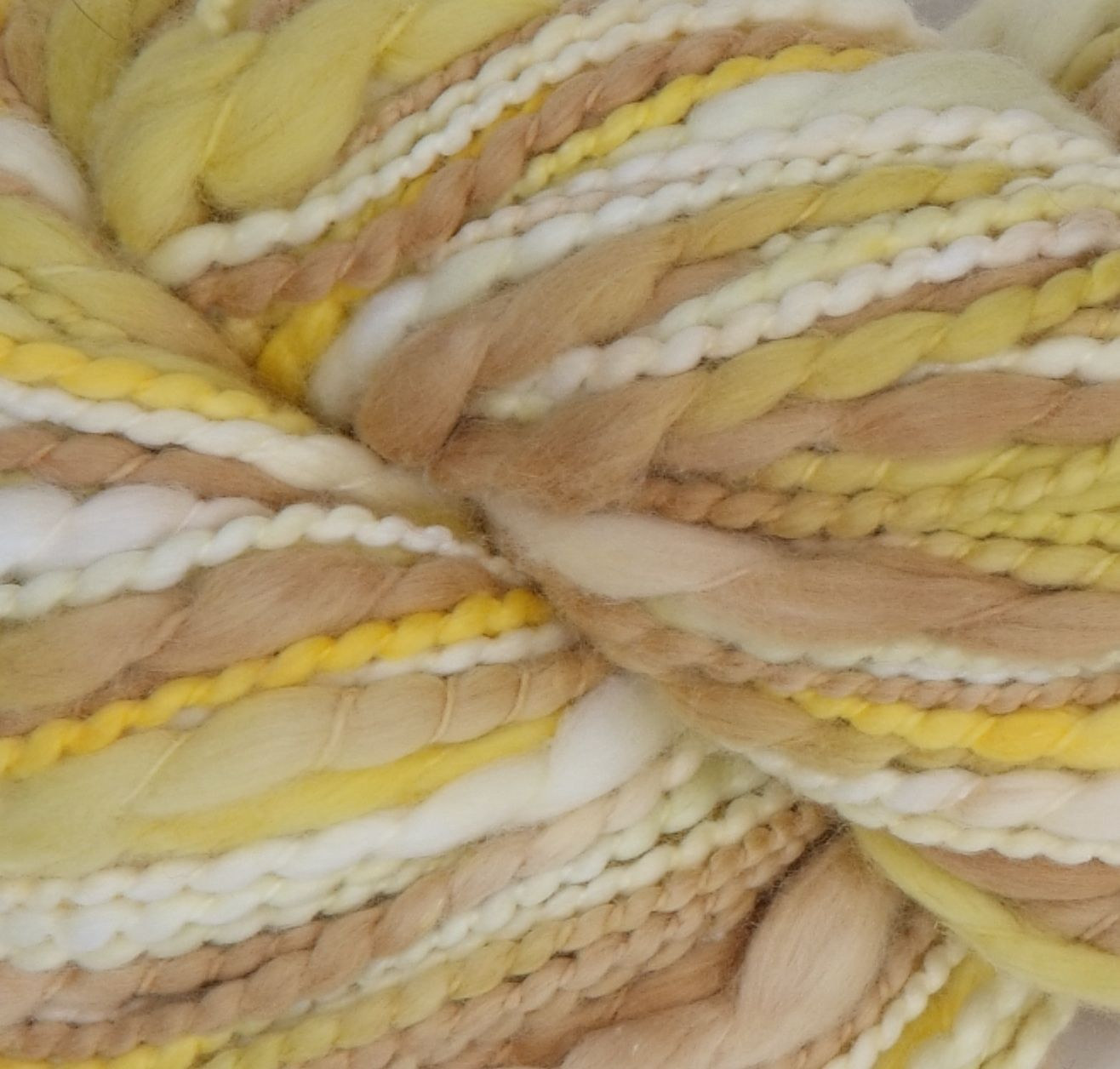 Lecco in Yellows.  Lecco is our new 100% Cotton yarn.  Each ball weighs 100g (3.5 oz) and has approximately 100m (110 yds).  We recommend a needle size of 6-8 mm/ 10–11 US to get 3.5 stitches per in.    Lecco is a super soft thick and thin 100% cotton yarn that provides lots of texture for that special project in mind.  Available in solid and gorgeous variegated color palettes. Perfect yarn for newborn and beyond. Visit our website to find a retailer near you.