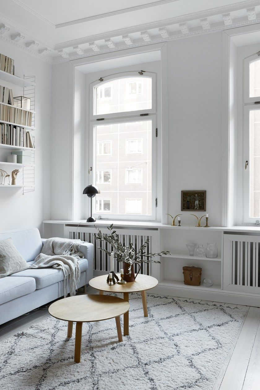 Light bright living room with period details painted wooden floors and scandi style furniture love the string shelf and moroccan beni ourain style rug