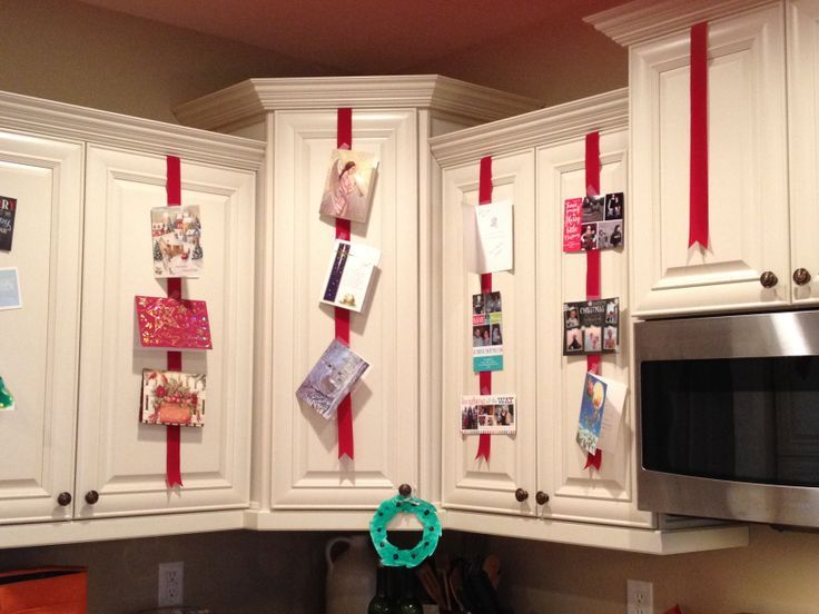 Christmas Ribbons On Cabinet Idea To Display Christmas Cards Tape Red Ribbon To Inside Cabinet Holiday Card Display Christmas Card Display Christmas Deco