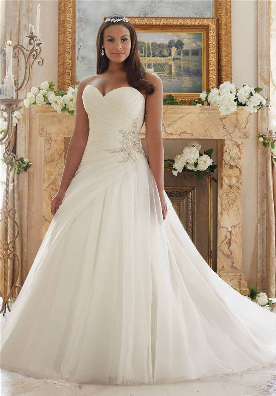 23246c8c9e Bead Side Piece and Asymmetrical Skirt - Wedding Dresses for Big Busts  Tips  and Top Picks - EverAfterGuide