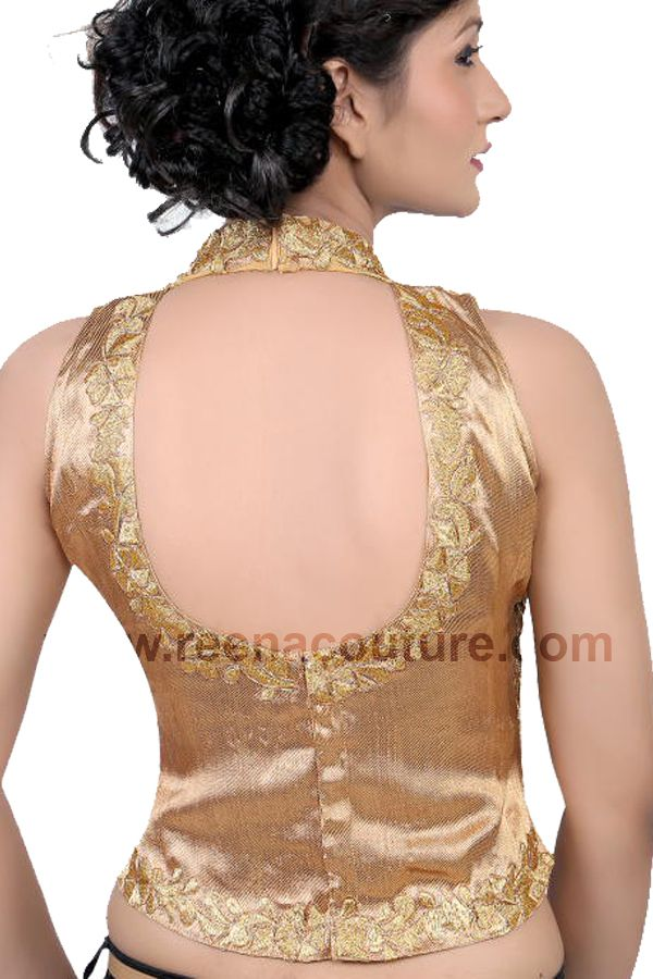 Shining golden padded blouse with #collar #strap and #embroidery work on the front side available in different colors and all #sizes. To order, call 9819416785 or visit www.reenacouture.com