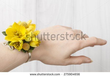 stock-photo-wrist-corsage-made-of-yellow-flowers-275904656.jpg (450×315)