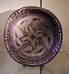 The Samarra Bowl, Mesopotamia, Uruk Period, C. 4000 BCThe design consists of a rim, a circle of eight fish, and four fish swimming towards the center being caught by four birds. As is typical of...