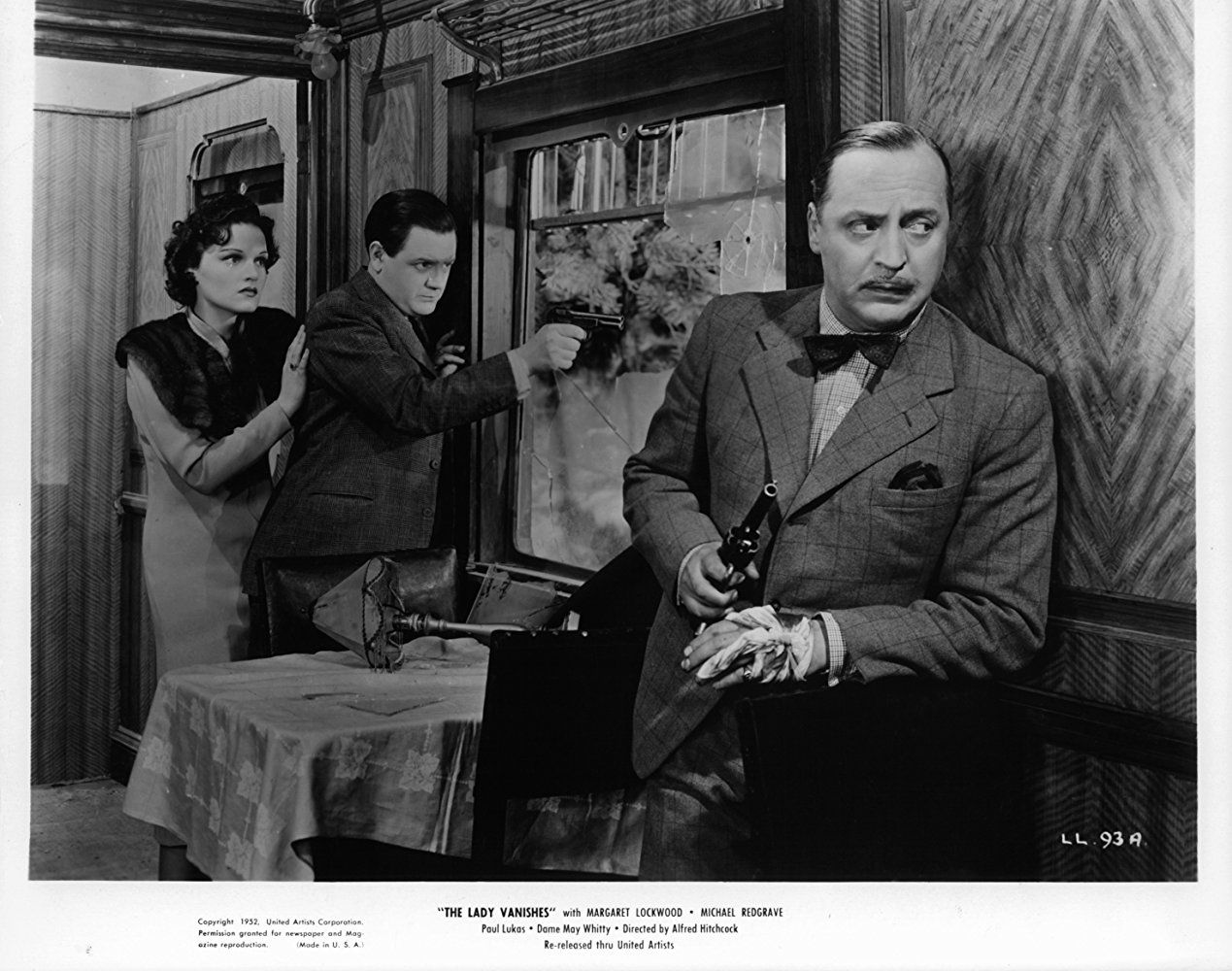 Stiff upper lip: (L-R) Linden Travers, Naunton Wayne and Basil Radford shoot it out with the surrogate Hun in The Lady Vanishes (1938)