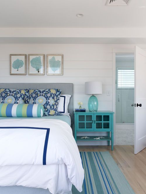 Large Beach Style Master Bedroom Idea In Portland Maine With White Walls  And Light Hardwood Floors
