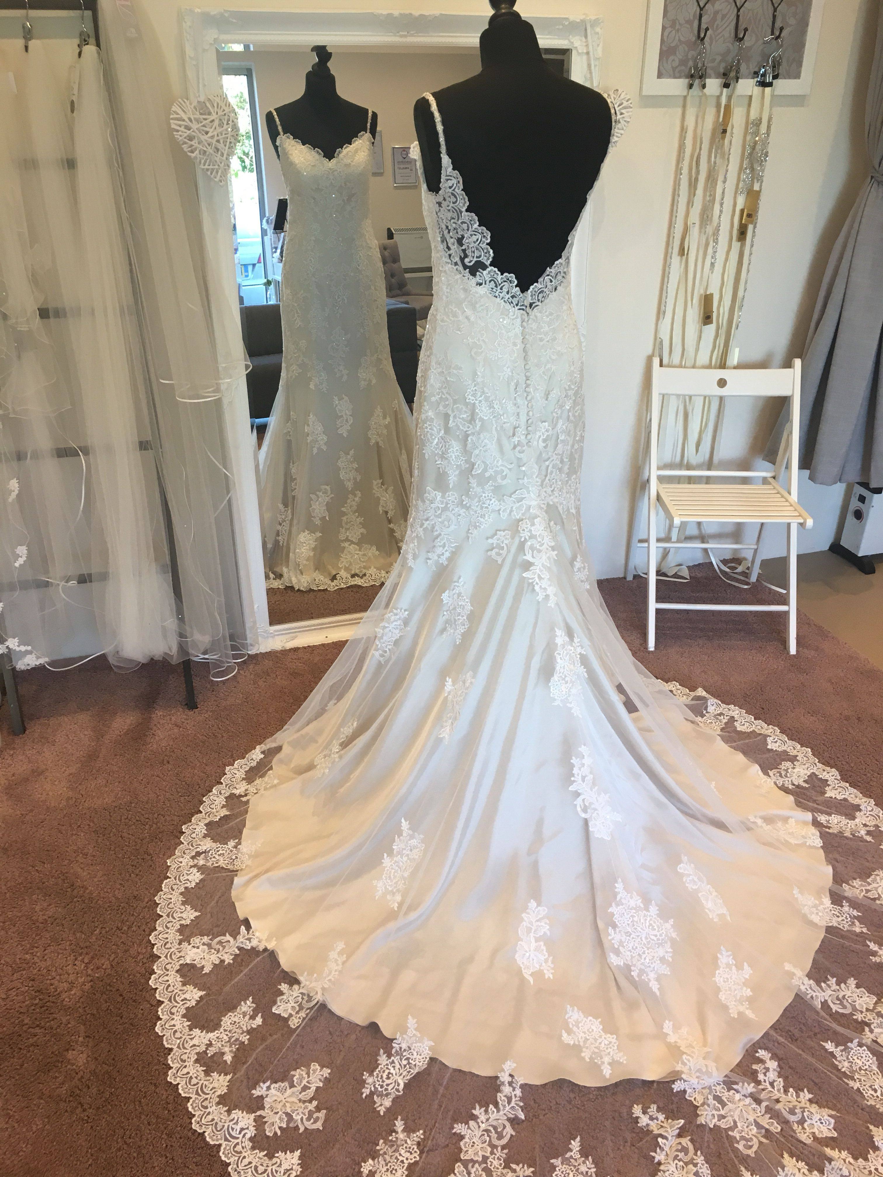 Champagne fitted wedding dress with ivory lace train