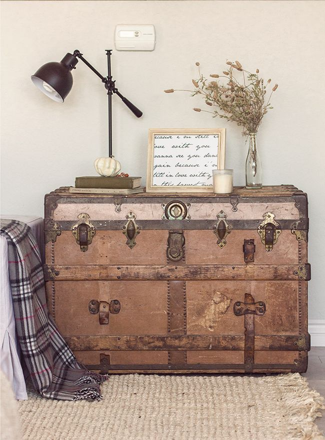 Black trunk - need feet also Vintage trunk as a side table - part of this stunning home tour eclecticallyvintage.com