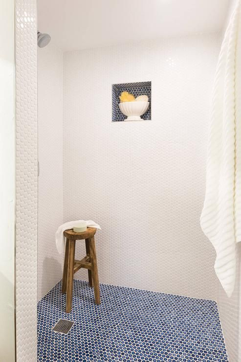 Blue And White Walk In Shower Is Clad In Blue Penny Floor Tiles Framed By White Penny Wall Tiles Fixed A Blue Bathroom Interior Penny Tile Penny Tiles Bathroom