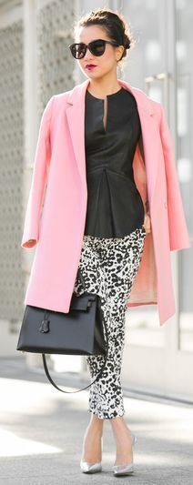 Pink cots, black bag, shirt and black and white pants street style