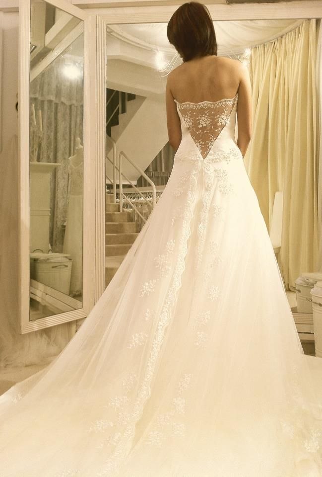 Margaret Brides: see through V-shaped lace bodice back and lace scalloped trimmings on centre slit skirt
