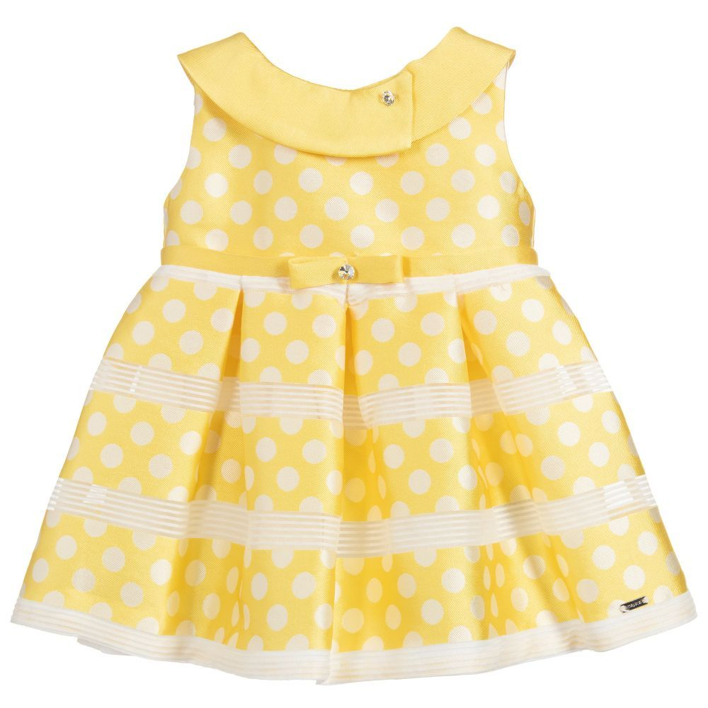 27a764a6 Younger girls yellow dress from Mayoral, with a white dot pattern. Made in  a lightweight satin, with a soft cotton lining. It has a bow on the waist,  ...