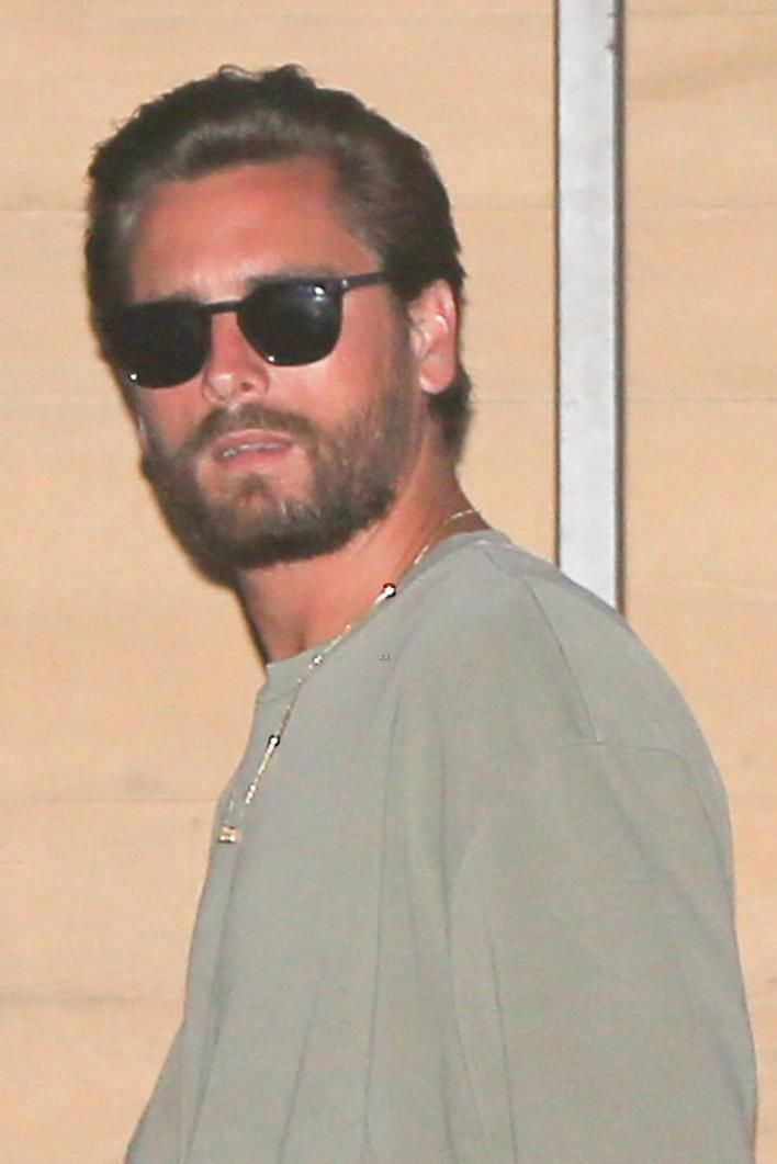 0180f8bb45f Scott Disick wearing Saint Laurent Classic 28 Sunglasses in Shiny Black  Acetate with Smoke Lenses and John Elliott Mercer Cotton-Jersey T-Shirt