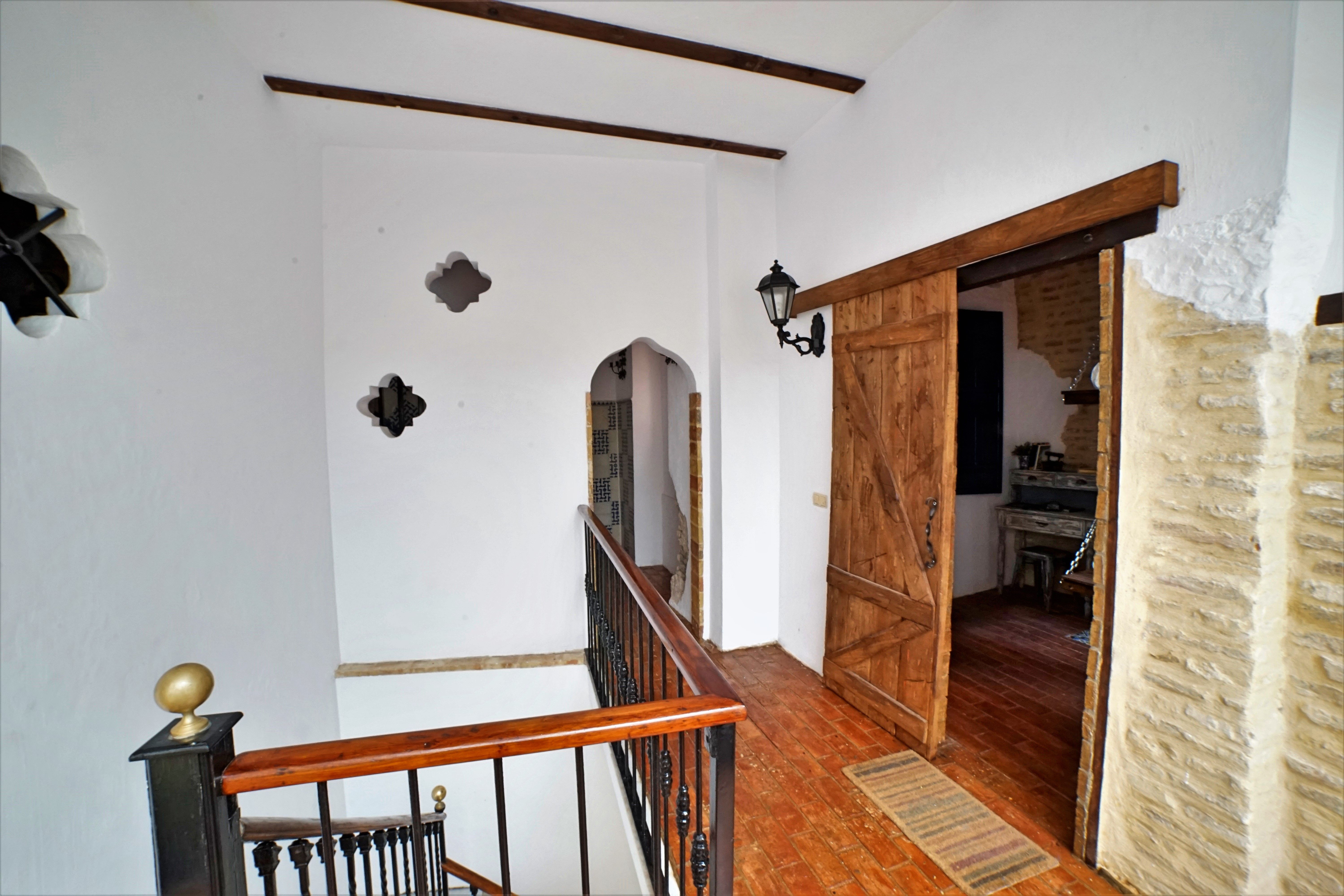 Unique Experience In Seville Sevilla Spain Restored Spanish House Rustic House With Distressed Stone Brick Wa Rustic Patio Doors Rustic Doors Diy Flooring